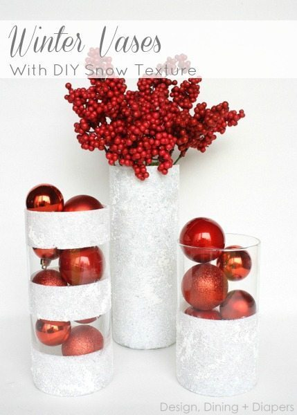 Make these winter vases from dollar store finds and a little snow texture paint! What a fun, inexpensive holiday DIY project!