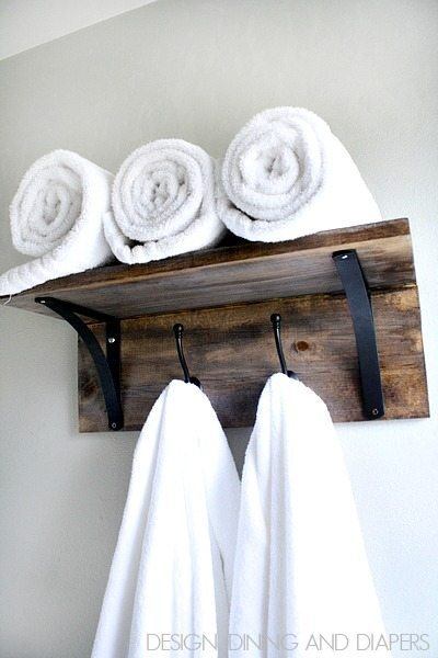 DIY Towel Organizer! This easy bathroom project will take you no time. Don't worry about folding those towels anymore, just hang and go!