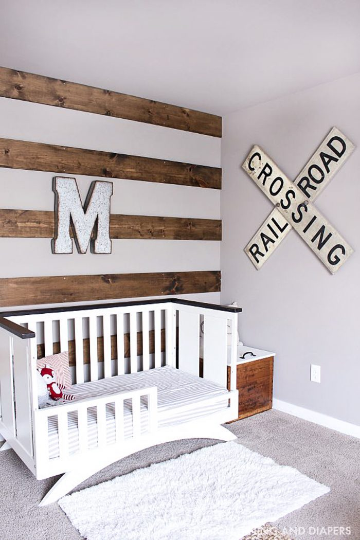 Learn how to install this DIY Wood Accent wall in a bedroom or nursery! This wood striped wall is a great way to add texture and a rustic style to a space.