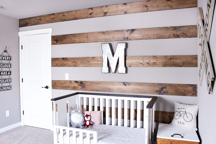 Turn that large blank wall into a wood accent wall by adding stripes with wood!