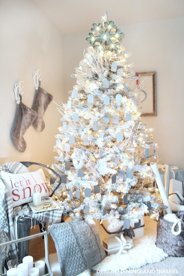 create a magical rustic modern christmas display using a white christmas tree and ombre gray ornaments
