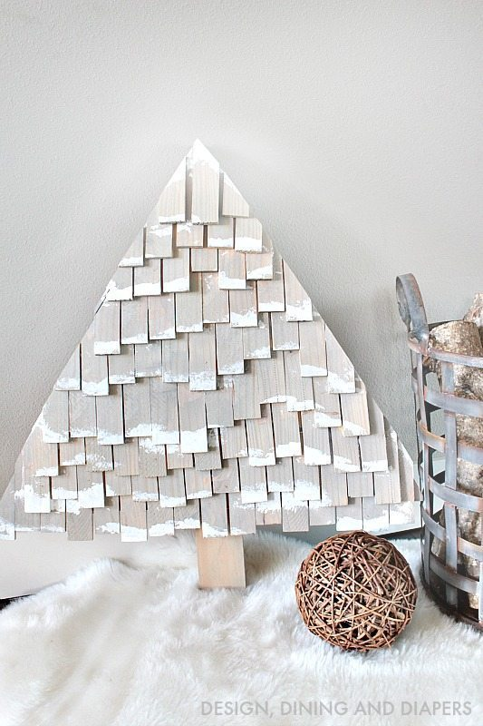Try making these unconventional and rustic Christmas Trees using wood shims, gray stain and paint! These DIY Christmas Trees would be perfect for your yard or against your fireplace!