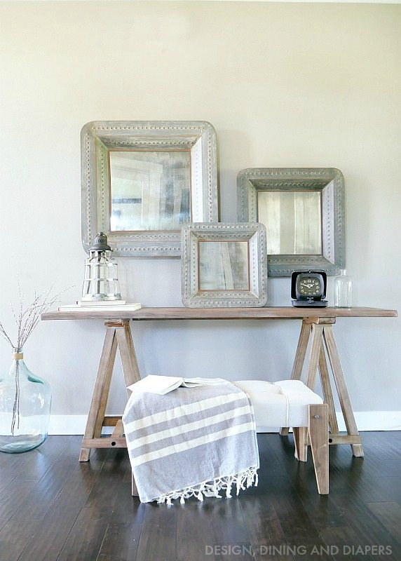Farmhouse Chic Front Entry Way with sawhorse entry way table and large rustic mirrors