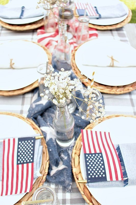 Here are a few great ideas for putting together patriotic table decorations using items from around the house and the dollar store!