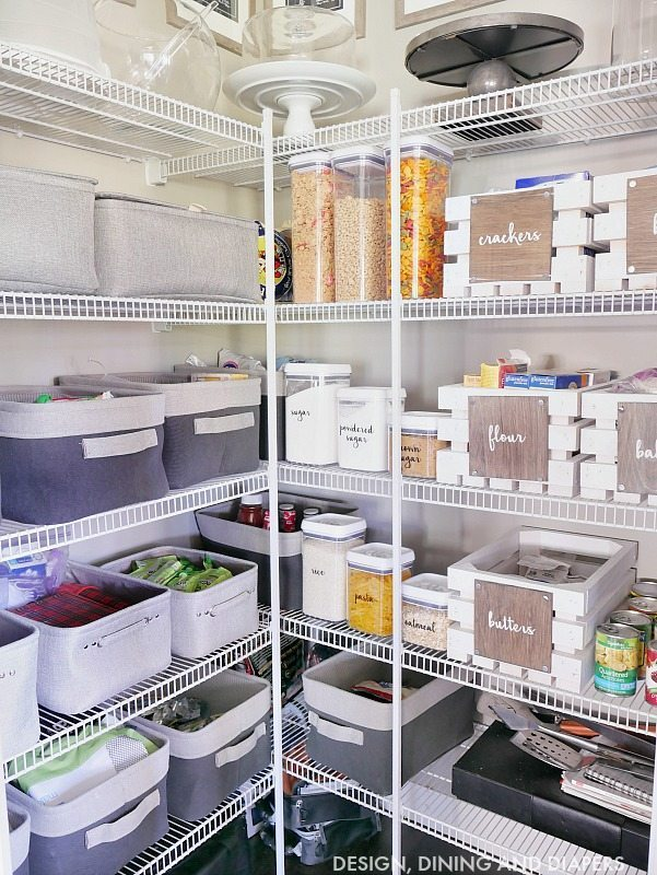 Need to get your pantry organized? Check out this pantry organization system using wooden crates and bins to help keep lunch items organized and dry food. Click for full resources.