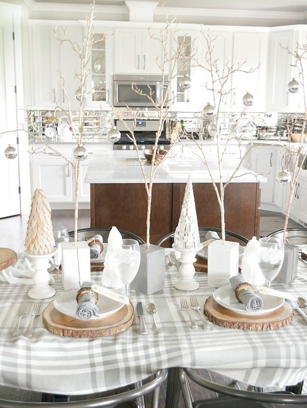 Cozy and Elegant Winter Table Setting with gray and white plaid tablecloth and gold accents
