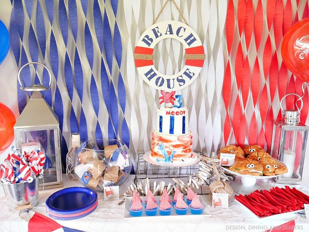 Nautical Birthday Party Ideas! This red, white and blue themed party is perfect for kids of any age. Love all the crab party decor and fun food ideas.