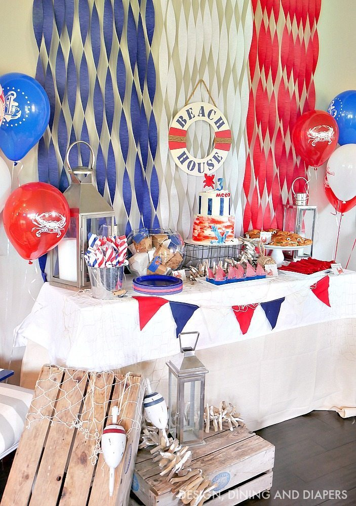 Look at this adorable Nautical Themed Birthday Party! I love all the crab party decor and food and tons of nautical decor touches. Cute kid's party ideas.