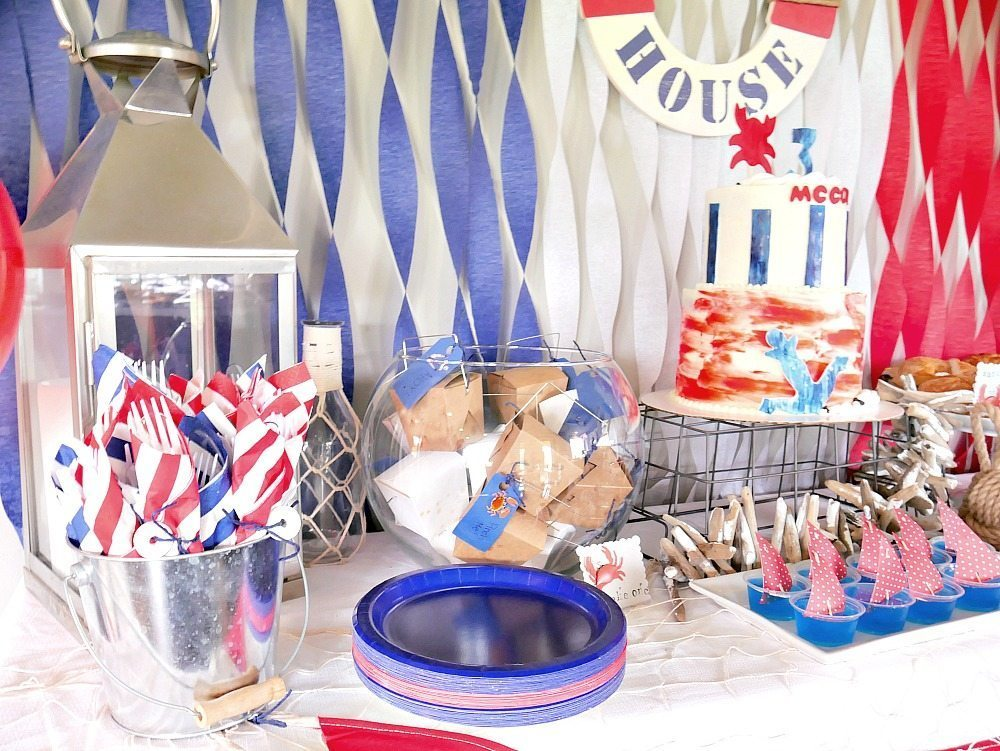 Nautical Birthday Party Display! Love the life saver utensil wraps and sail boat jello!