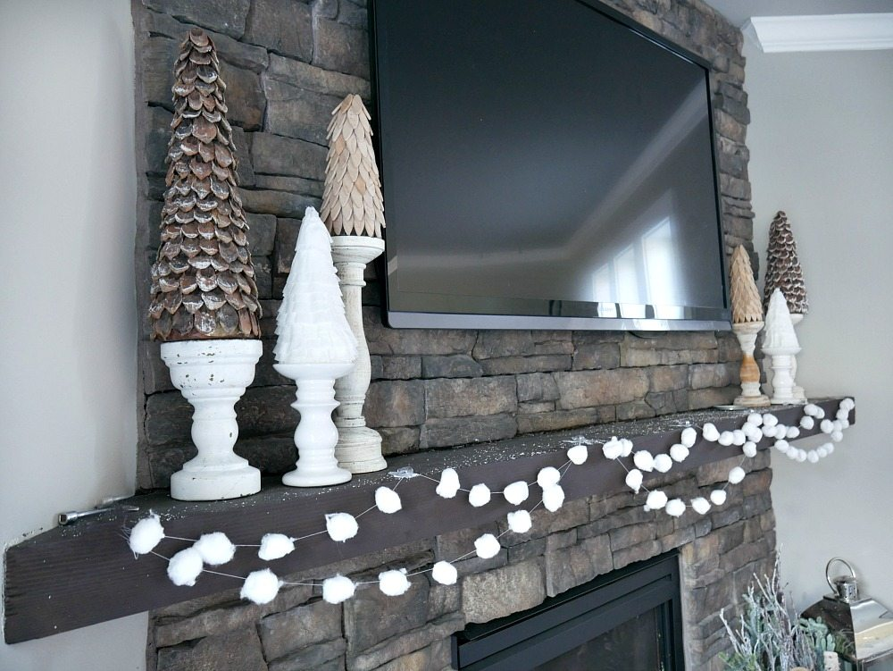 Decorating a mantel with a TV - Learning how to decorate around the distraction with simple touches
