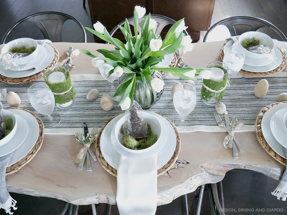 Neutral Easter Tablescape using white tulip centerpiece with chocolate bunnies and natural textures.
