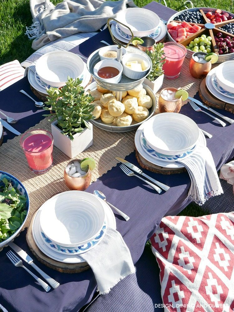 Create a casual Blue and White Backyard Table Setting as your guests sit comfortably on the grass with lots of pillows and blankets! Get tons more summer entertaining ideas on the blog.