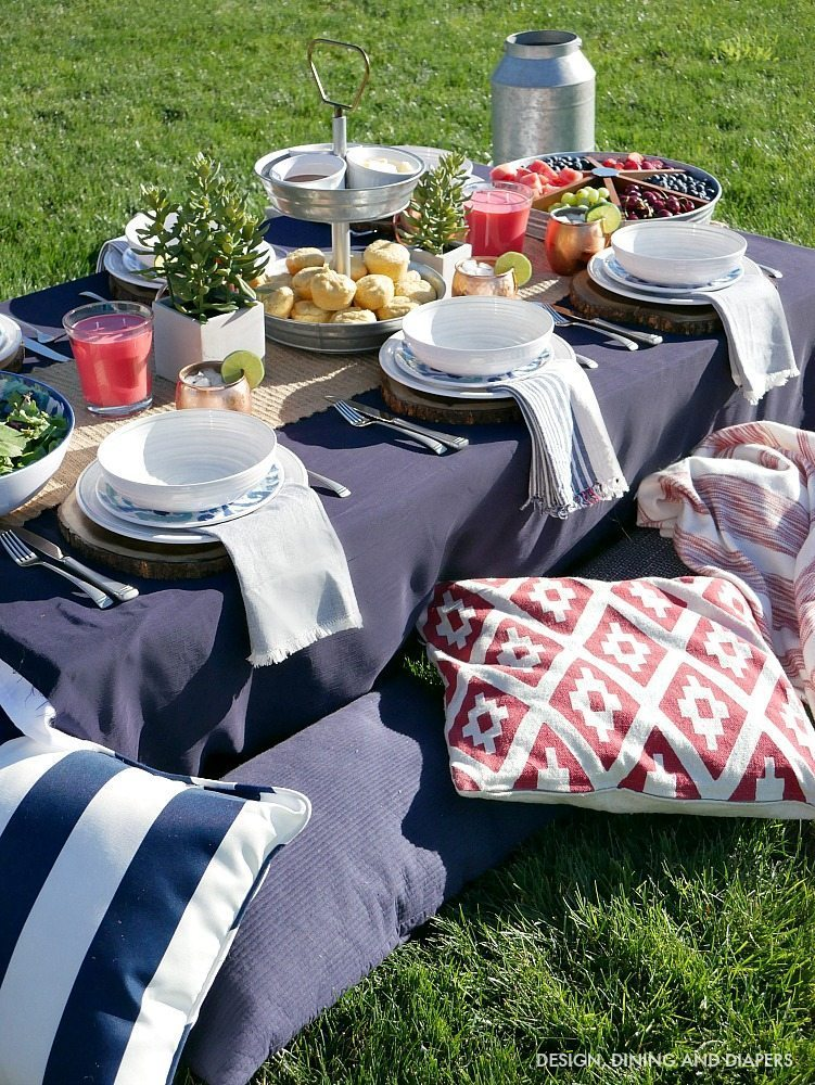 Low Style Picnic Table With Comfy pillows for seating - Click for more summer entertaining ideas