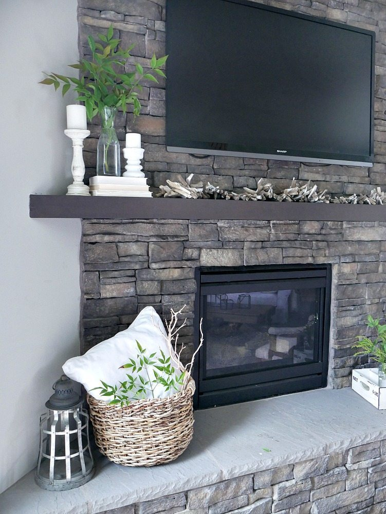 coastal summer mantel with driftwood garland and fresh greens