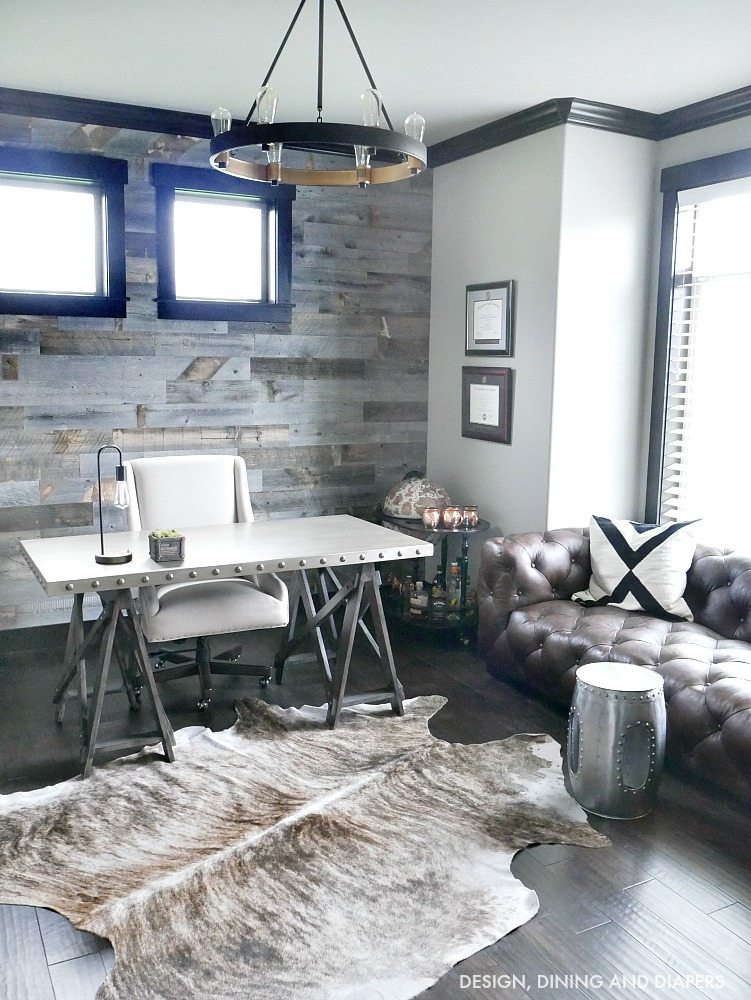 Modern Rustic Office - Come take a tour of this home office with dark wood trim and masculine touches. The reclaimed wood wall makes such a statement.