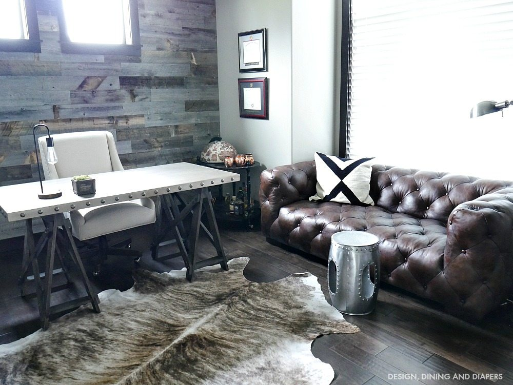 Brown Leather Chesterfield Sofa in dark rustic office design