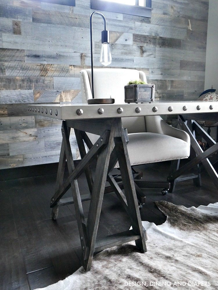 Industrial office Desk in a metal finish! Looks so good in front of this Stikwood Reclaimed Wood Wall