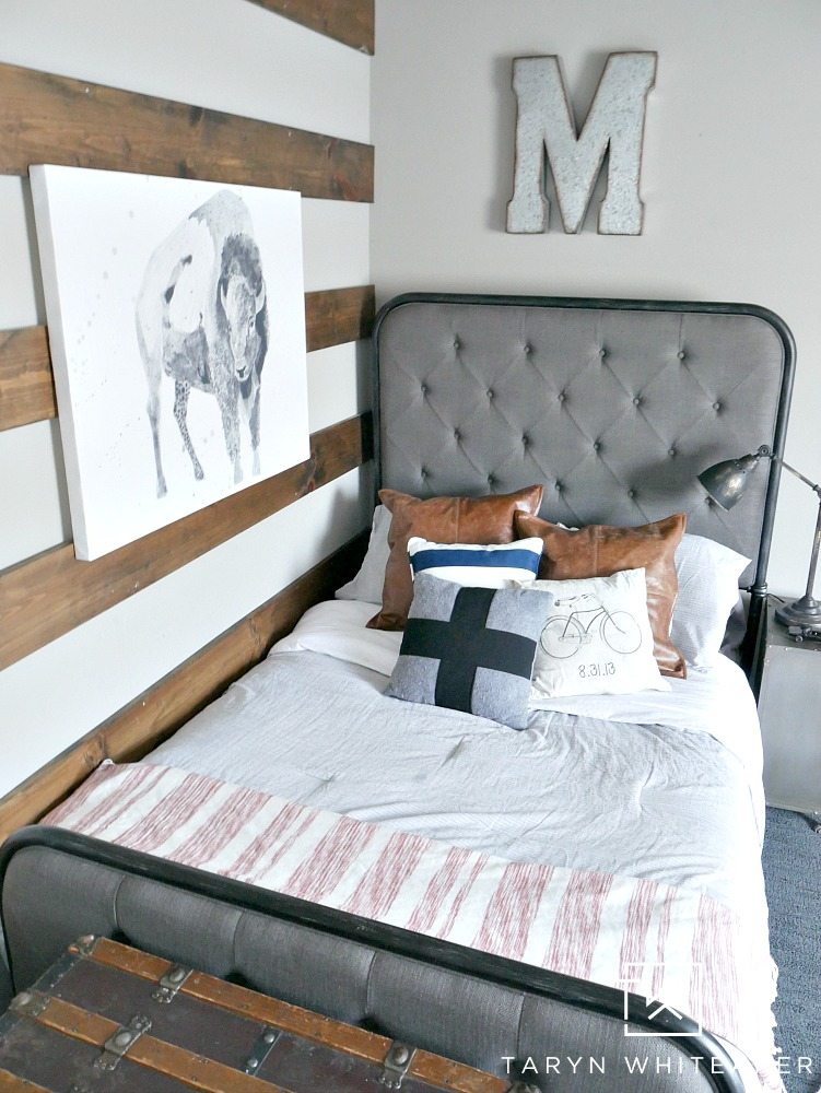 Modern Farmhouse Boy Room with wood striped wall and black and white animal print!