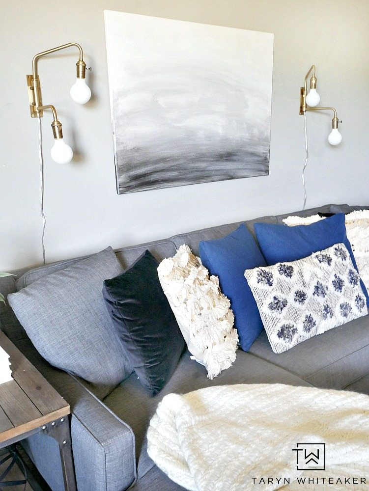 Create a sleek yet cozy space with this modern boho decor look for a small seating area. The mix of black, cream and indigo blue bring a neutral yet bold look to the space.