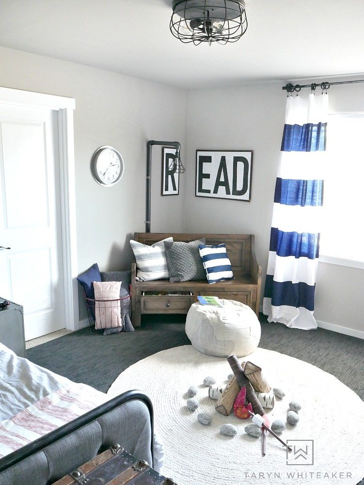 Come take a tour of this rustic boys room with navy black and white decor! Love all the vintage touches and fun accents.