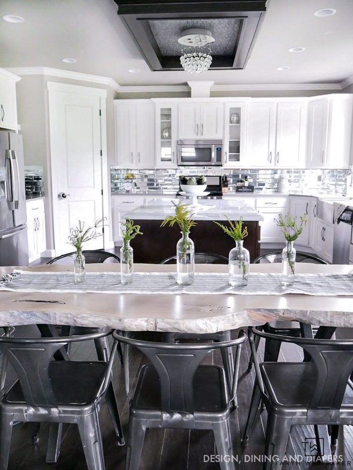 Black and white kitchen with contemporary design - get the tips for what this homeowner would do differently!