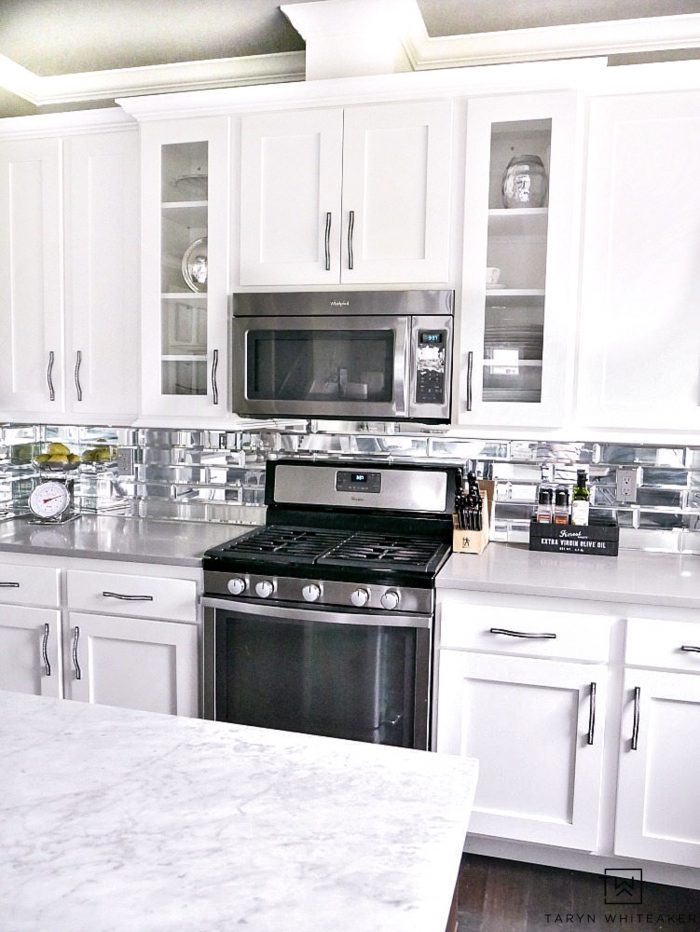 White kitchen cabinets and mirror subway tile. Learn the good and bad of this kitchen!