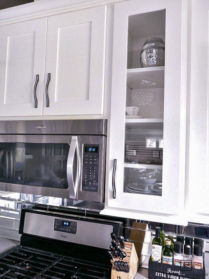 Open shelves around stove.