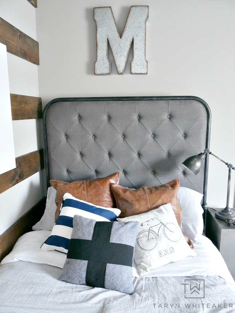 Rustic Modern Boy Room with leather pillows and black and navy accents