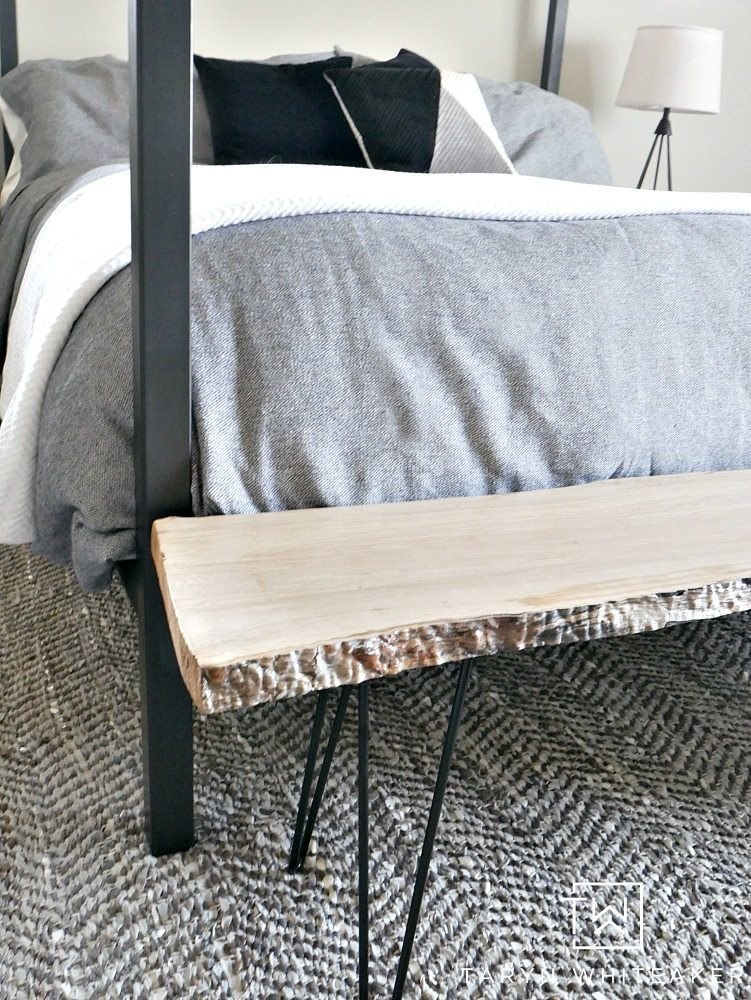 A rustic modern bedroom mixing steel, wood and lots of neutral textures
