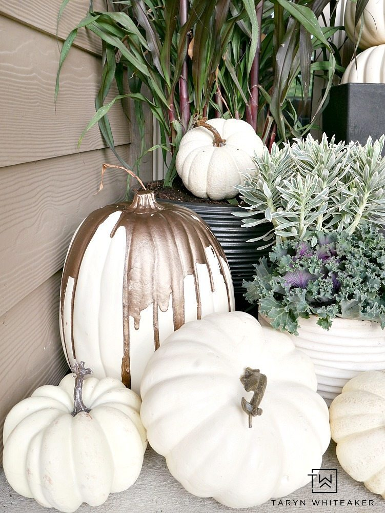 Collection of white pumpkins displayed on front porch for fall.