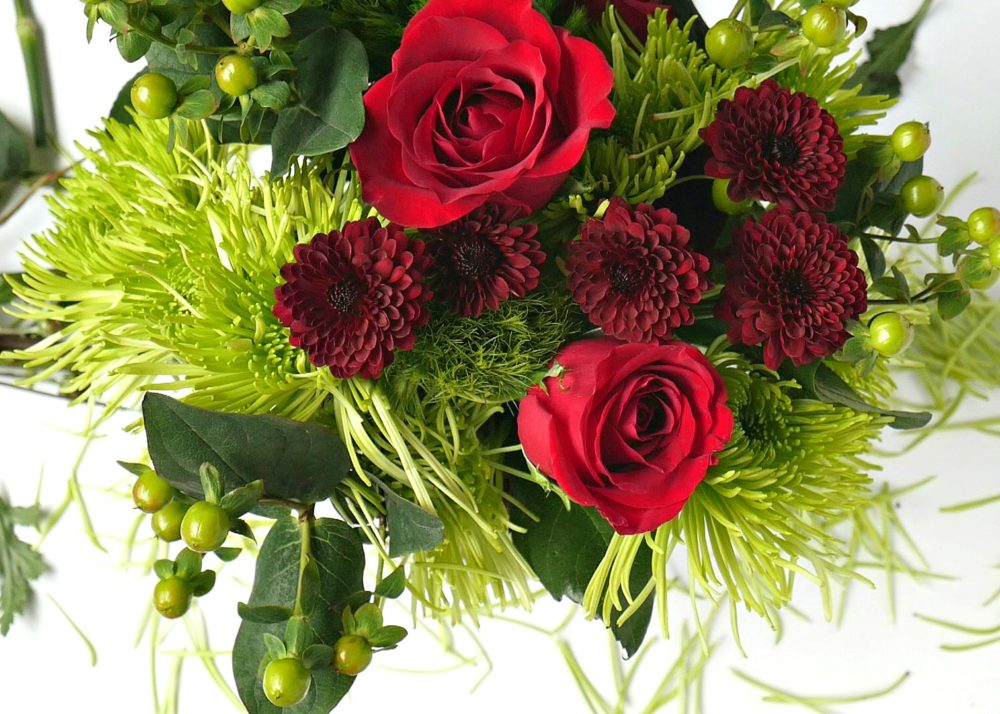 Tips for arranging grocery store flowers taryn whiteaker group a few pops of red together and place them sporadically around the display its always good to spin the bouquet around and do a check izmirmasajfo