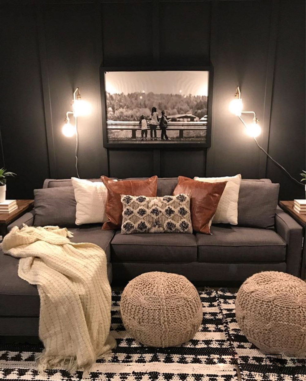 Don't be afraid of using a bold dark paint on your walls! The charcoal gray walls make a huge impact in this rustic modern movie room!