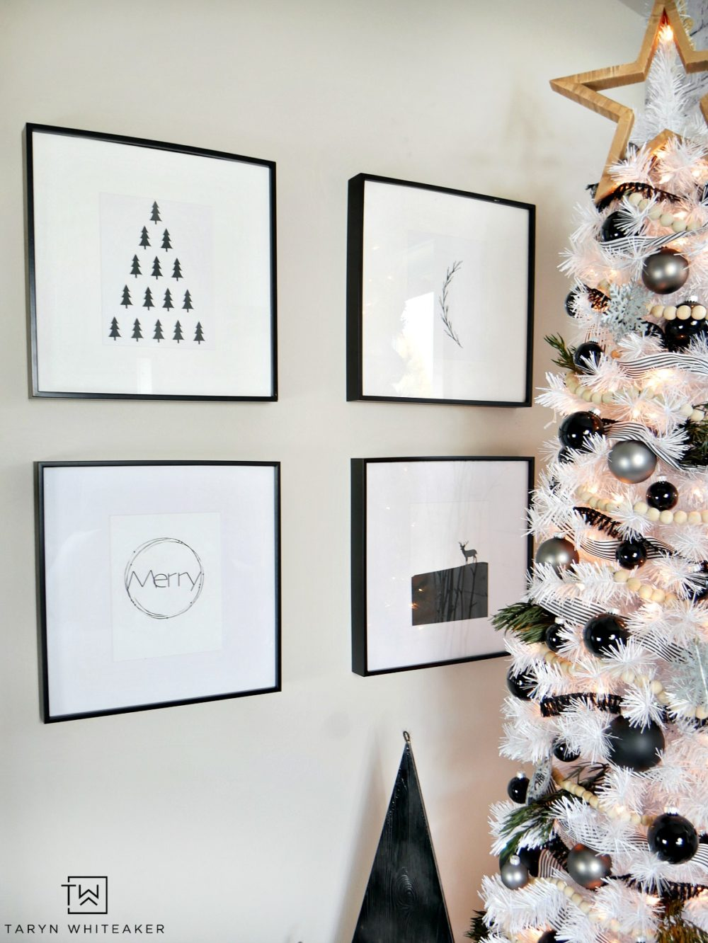 Taryn creates this Modern Black and White Christmas Tree display in her home using a tall white skinny tree with black and silver ornaments and wood!