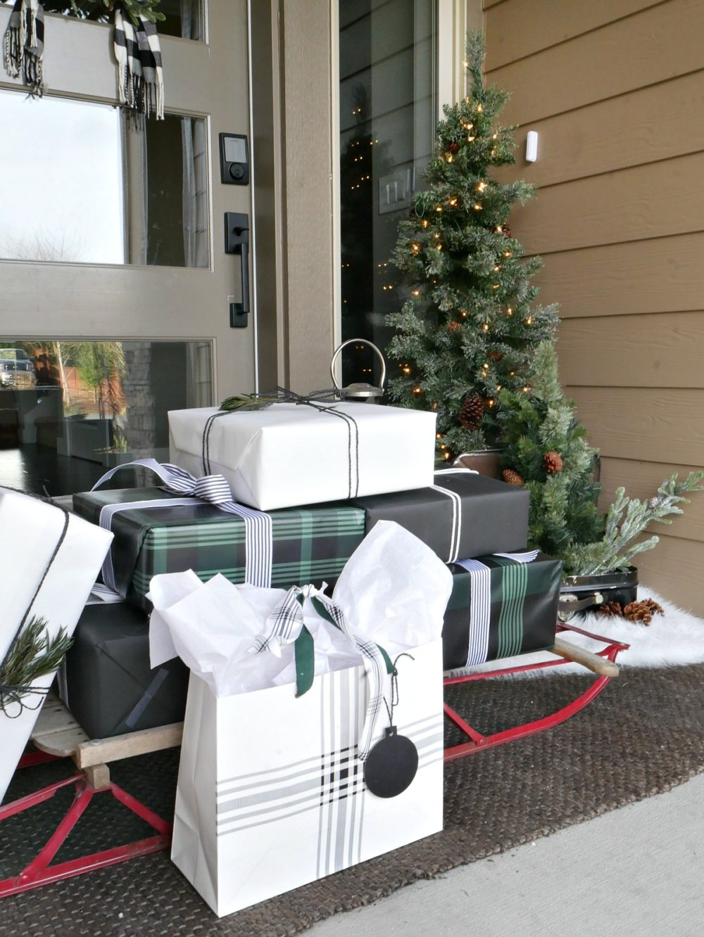 Christmas porch - a welcoming sight with a sleigh of presents