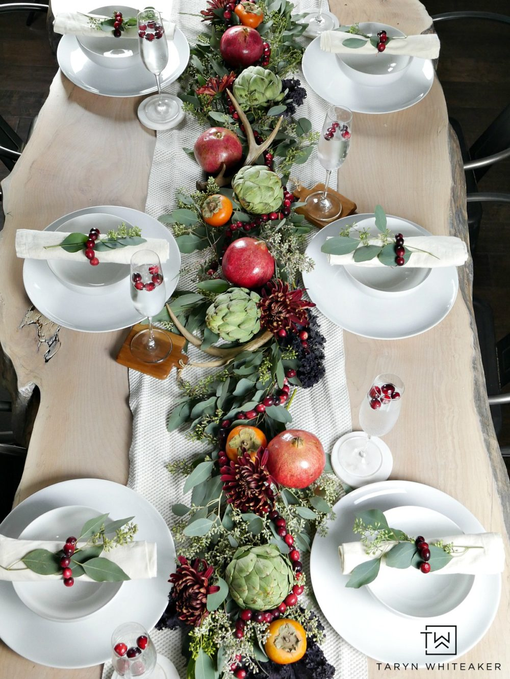 Gorgeous and classy fall table decor using pomegranates, artichokes and cranberries. Love all the natural colors of all brought into this table.