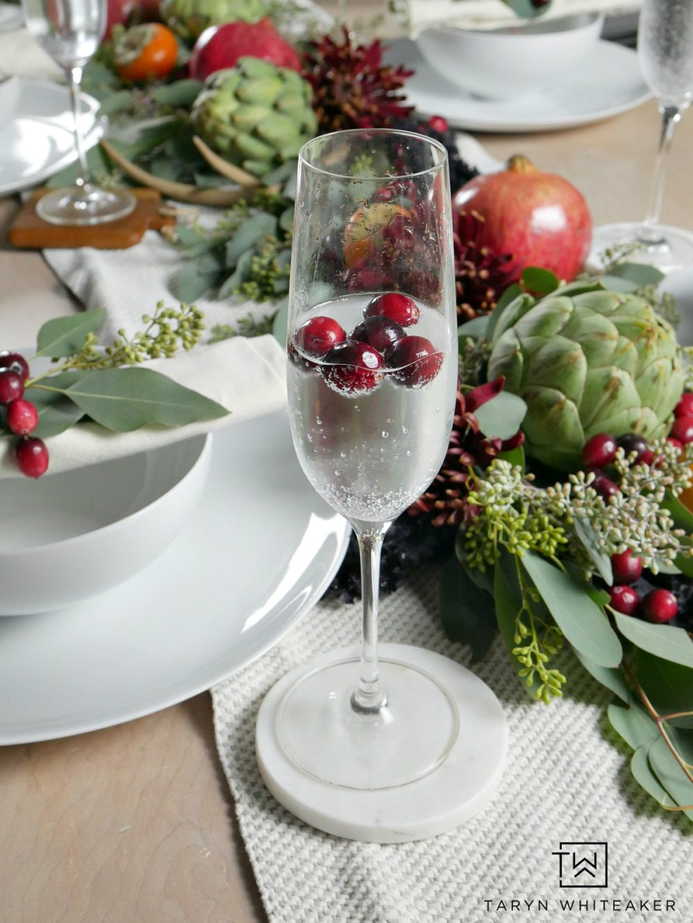 Thanksgiving tablescape featuring cranberries floating in champagne glasses