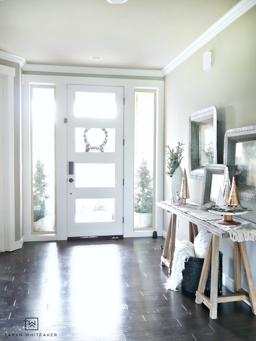 Simple, serene entryway that focuses on clean lines and pops of texture. This Christmas Entry way is filled with simple yet meaningful decor.