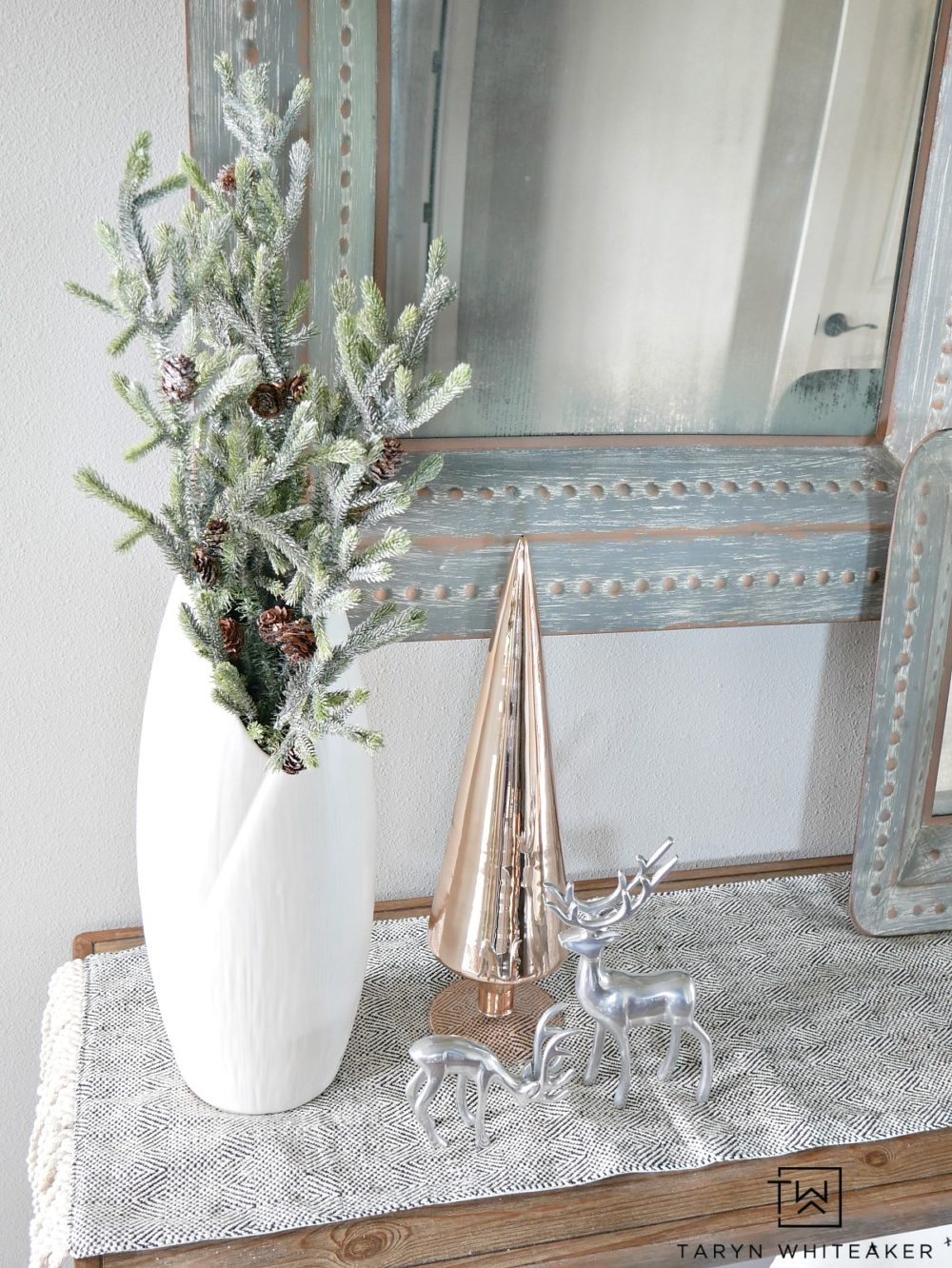 Make subtle touches to your entry way to create this Chic Christmas Entry Way using rustic metals, distressed wood paired with metallic trees and greener!