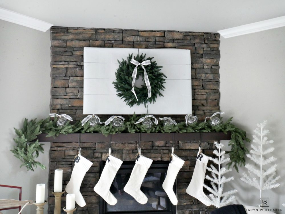 Cover your TV with butcher paper and hang a wreath to hid it for those holiday parties! It's an easy way to transform your vignette and keep people focused on the company not the screen.