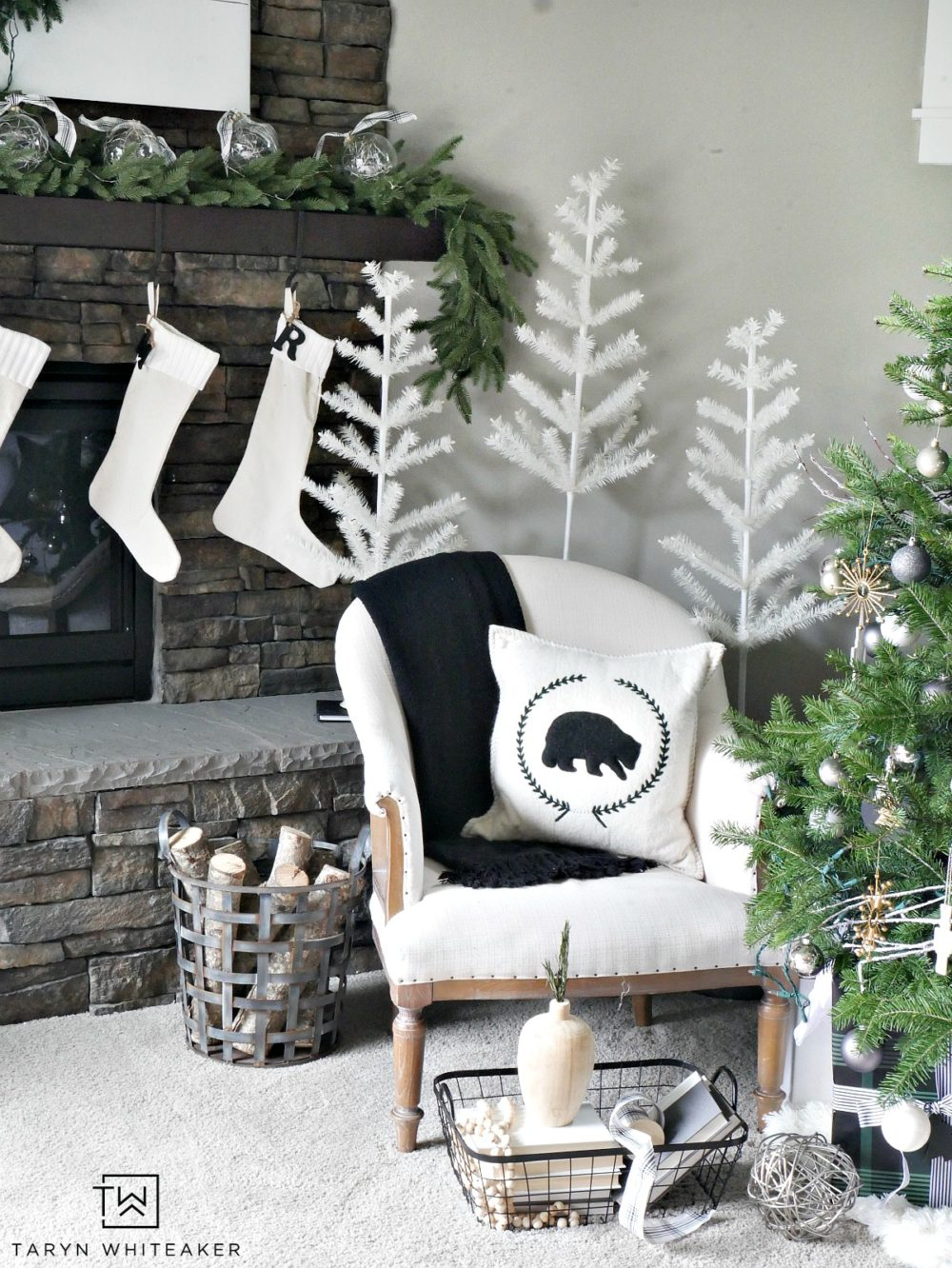 Create a winter wonderland forest in your home with these modern and simplistic trees! Recreate this Neutral Christmas Mantel using lush greenery, winter white and pops of black and plaid. This look is fresh, clean and festive.