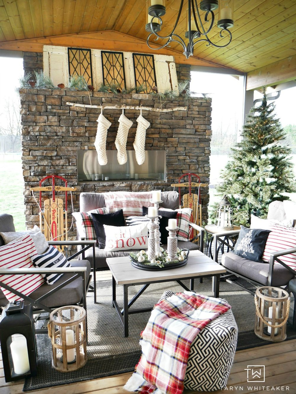 Come see our Outdoor Living Space at Christmas ! It's feeling oh so cozy with it's own Christmas tree, stockings and lots of plaid!