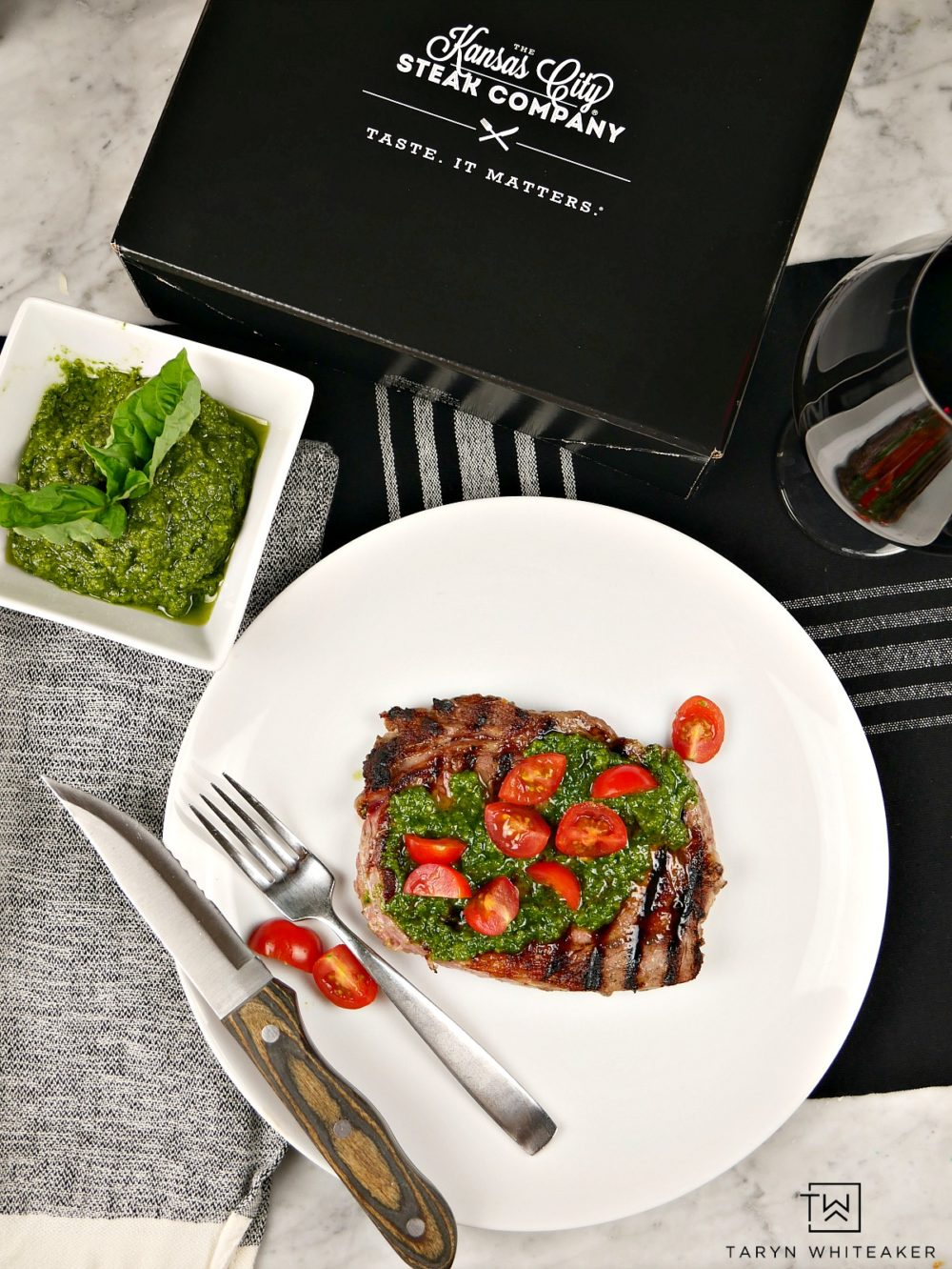 Create a festive look and taste for your steak this holiday season with a homemade pesto sauce topped with bright red tomatoes!