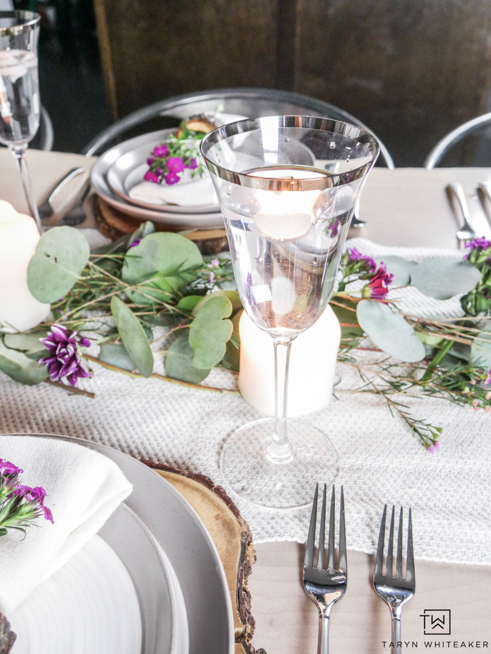 Romantic and whimsical table setting with fresh greens, neutral tones and pops of pink.