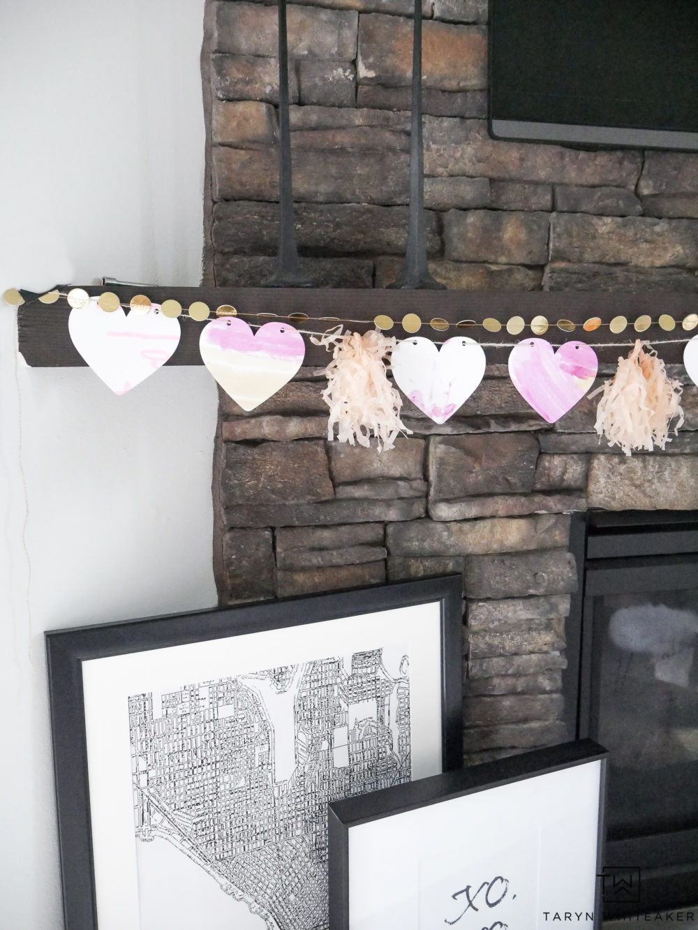 Learn how to create this Simple Valentine's Day Mantel using your kids' artwork! It's always fun to add a little festive cheer to your home especially with handmade art!
