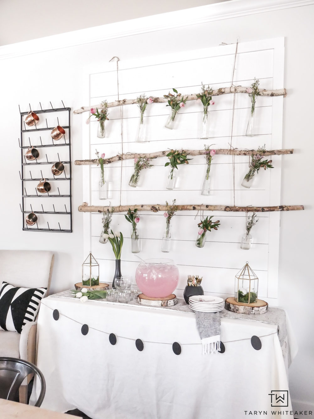 Great this DIY Hanging Floral Backdrop that is perfect for a spring or Easter entertaining! These Hanging Jars from birch branches are an easy DIY project that will wow your guests!