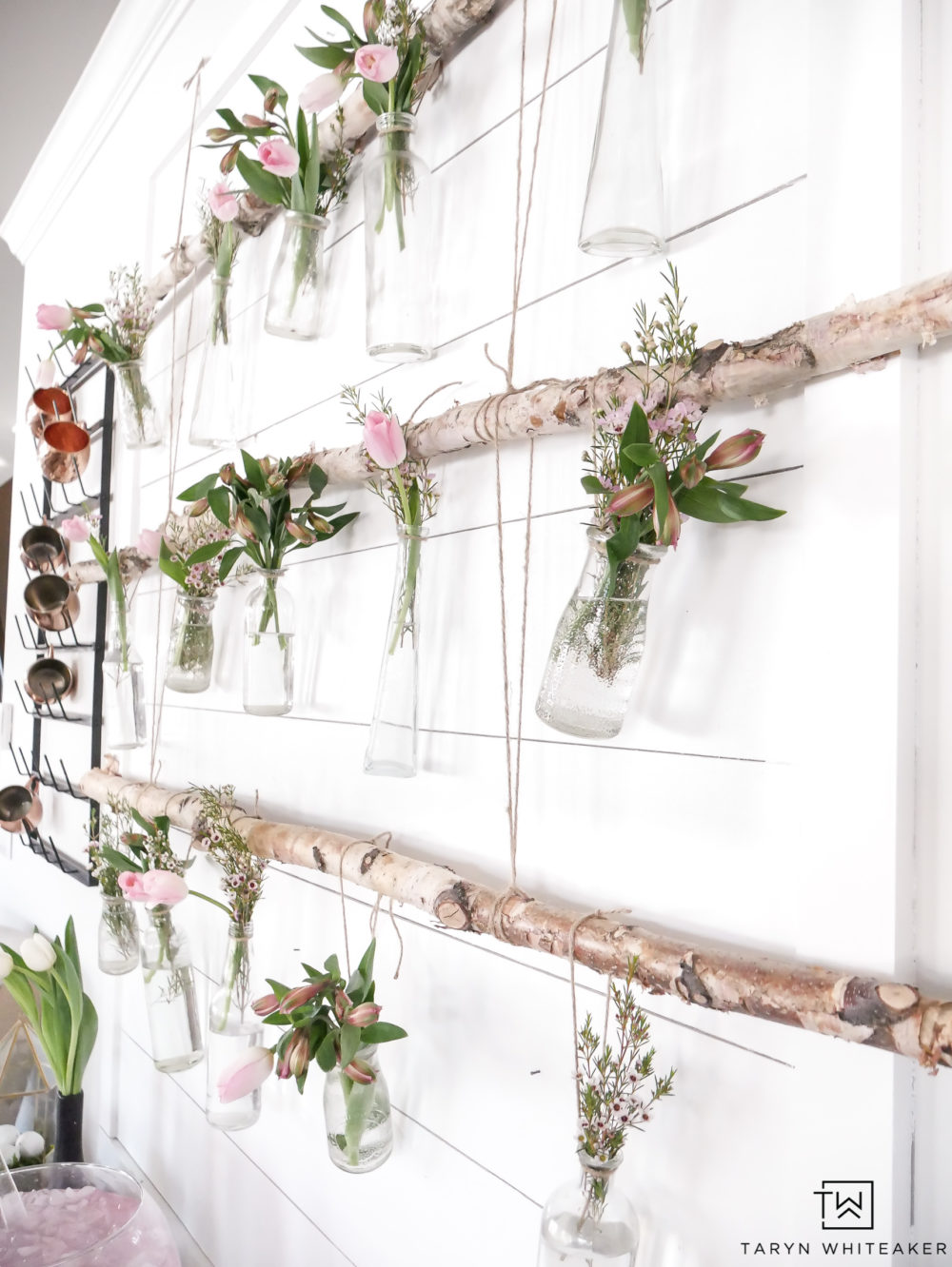 Easily create this Hanging Branch Display with fresh garden flowers for your next spring party!