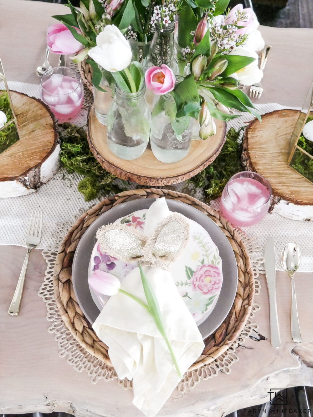 Looking for fresh Easter Table Ideas? Easily recreate this Enchanting Pink and Green Easter Table that incorporate lots of moss and wood rounds with pops of fresh flowers!