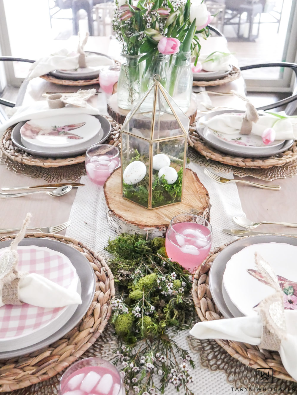 Simple and sweet Easter table decor with moss center piece and pretty pink plates! Those gold terrariums are so simple to put together too!