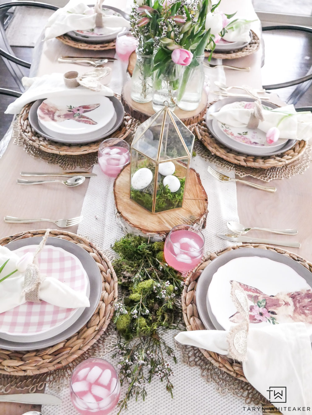 Nature themed Easter tablescape with pink and gold accents.
