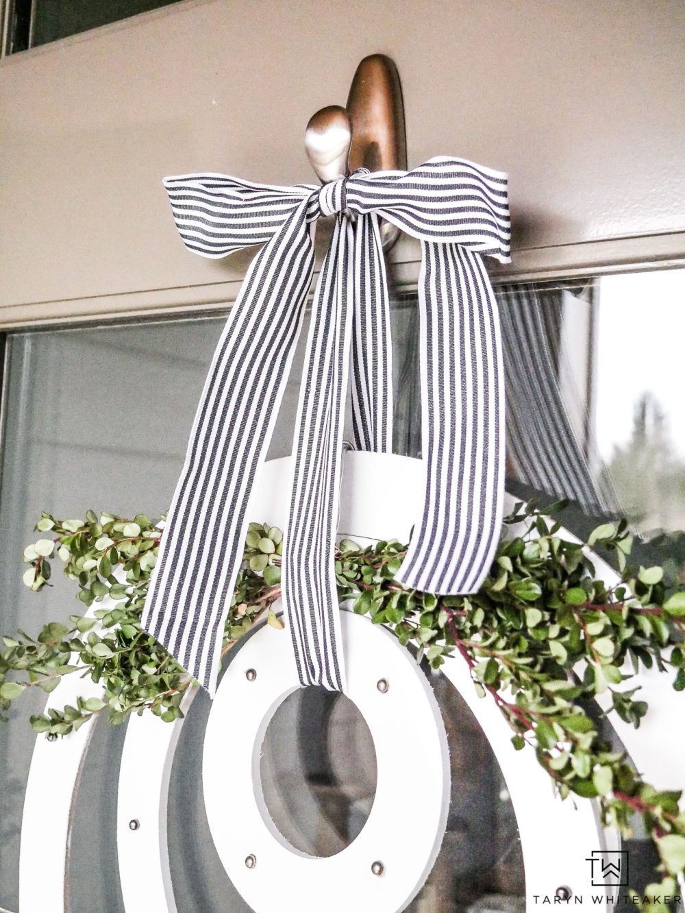 A black and white striped bow and a little boxwood makes such a classic look for spring!